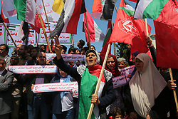 April 15, 2018 - Gaza, Pennsylvania, Palestine - Palestinian protesters chant slogans and wave the flags of Palestine, Syria and Iran during a demonstration against strikes carried out by the United States, Britain and France against Syria's regime, in Gaza City on April 14, 2018, during a demonstration called for by the Popular Front for the Liberation of Palestine (PFLP) and other left-wing parties. (Credit Image: © Majdi Fathi/NurPhoto via ZUMA Press)