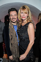MATTHEW WILLIAMSON and MERVE LIEBELT at the launch of Maison Triumph, 71 Monmouth Street, Covent Garden, London on 14th February 2013.
