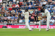 Sam Curran of England hits the ball to the boundary for four runs during the first day of the 4th SpecSavers International Test Match 2018 match between England and India at the Ageas Bowl, Southampton, United Kingdom on 30 August 2018.