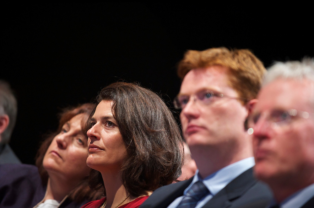 Miriam Gonza?lez Dura?ntez, Nick Clegg's wife, and MP Danny Alexander sit first row listening to speeches during the Liberal Democrats Autumn Conference in Liverpool on 19 September 2010.  This was the first party conference since the government coalition with the tories.