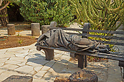 Statue of sleeping pilgrim in Capernaum, Sea of Galilee, Israel