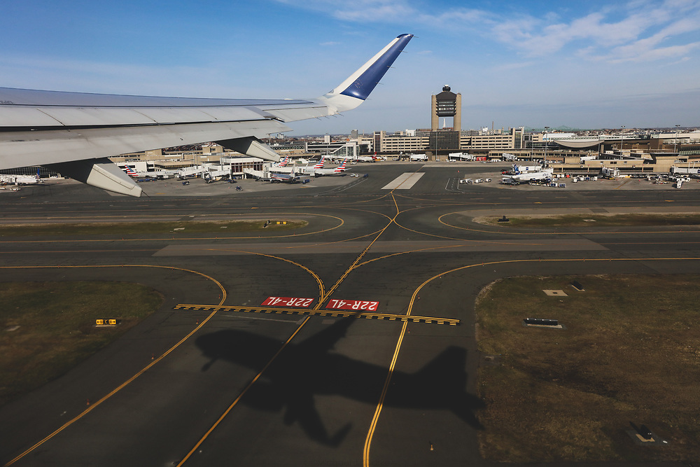 A window view during a takeoff from Boston's Logan International Airport.