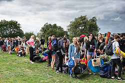 Young people queue patiently to gain access to the Brownstock Festival.
