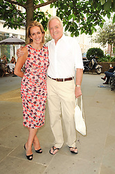 """CAROLINE MICHEL and JOHN RENDALL at a party to celebrate the publication of the Paper back edition of """"A Lion Called Christian"""" held at Julie's Restaurant & Bar, 135 Portland Road, London W11 on 28th June 2010."""