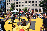 """Protesters taking a knee at """"Black Lives Matter Plaza"""" in Washington, D.C., joining thousands of people from all over the country demonstrating against racial injustice in the United States."""