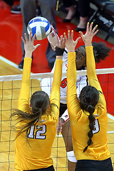23 November 2017:  Juma Armando attacks towards defenders Taylor Graboski and Brittany Anderson during a college women's volleyball match between the Valparaiso Crusaders and the Illinois State Redbirds in the Missouri Valley Conference Tournament at Redbird Arena in Normal IL (Photo by Alan Look)