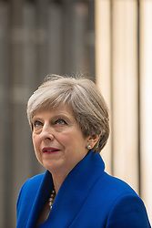 Prime Minister Theresa May makes a statement in Downing Street after she traveled to Buckingham Palace for an audience with Queen Elizabeth II following the General Election results.