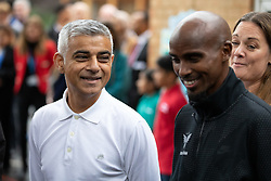 © Licensed to London News Pictures. 15/10/2018. London, UK. Mayor of London Sadiq Khan (left) and British athlete Sir Mohamed Farah (right) launch a campaign at Cubitt Town Junior School to encourage London schools to take part in the Daily Mile initiative. The Daily Mile gets school children exercising outside for 15 minutes a day, to improve their physical, social, emotional and mental health and wellbeing. Photo credit : Tom Nicholson/LNP