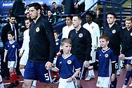 Scotland defender Scott McKenna (5) (Aberdeen), Scotland midfielder Callum McGregor (11) (Celtic) and Scotland midfielder John McGinn (6) (Aston Villa) during the Friendly international match between Scotland and Portugal at Hampden Park, Glasgow, United Kingdom on 14 October 2018.