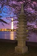 Japanese pagoda and cherry blossoms across the Tidal Basin from the Washington Monument, Washington, DC