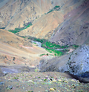 Berber village and farm terraces in deep mountain valley, Atlas Mountains, near Imlil, Morocco