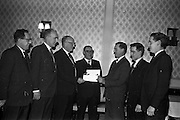 28/01/1963<br /> 01/28/1963<br /> 28 January 1963<br /> Esso National Roadside Gardens Competition Awards presented at the Anchor Hotel, Parnell Square, Dublin. Esso Petroleum Company (Ireland) Ltd. presented awards to the Dublin District winners in the Garage and Service Station Section of the competition in conjunction with Bord Failte.  Picture shows: Mr T.P. Downey, (3rd from right), Esso District Manager, presenting the awards to Mr Michael Sheridan (3rd from left) and Mr Hugh McGuiness (4th from left). Also in the picture are (from left): Mr M.J. Brickey, Esso Area Manager; Mr F.E. Morton, Esso Sales Manager; Mr Eamon McGuiness, son of Hugh, and Mr J.A. O'Brien, An Bord Failte.