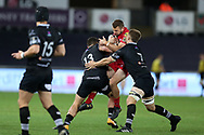 Paul Asquith of the Scarlets is stopped by Olly Cracknell ® and Kieron Fonotia of the Ospreys. .Guinness Pro14 rugby match, Ospreys v Scarlets at the Liberty Stadium in Swansea, South Wales on Saturday 7th October 2017.<br /> pic by Andrew Orchard, Andrew Orchard sports photography.