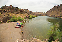 Paddles stop for lunch and beach their boats on the shore of The Black Canyon, Nevada.