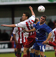Fotball<br /> England 2004/2005<br /> Foto: SBI/Digitalsport<br /> NORWAY ONLY<br /> <br /> Stevenage v Rochdale<br /> FA Cup Second Round. 04/12/2004<br /> <br /> Tony Gallimore (Rochdale) and Michael Brough (Stevenage) move in for the ball.
