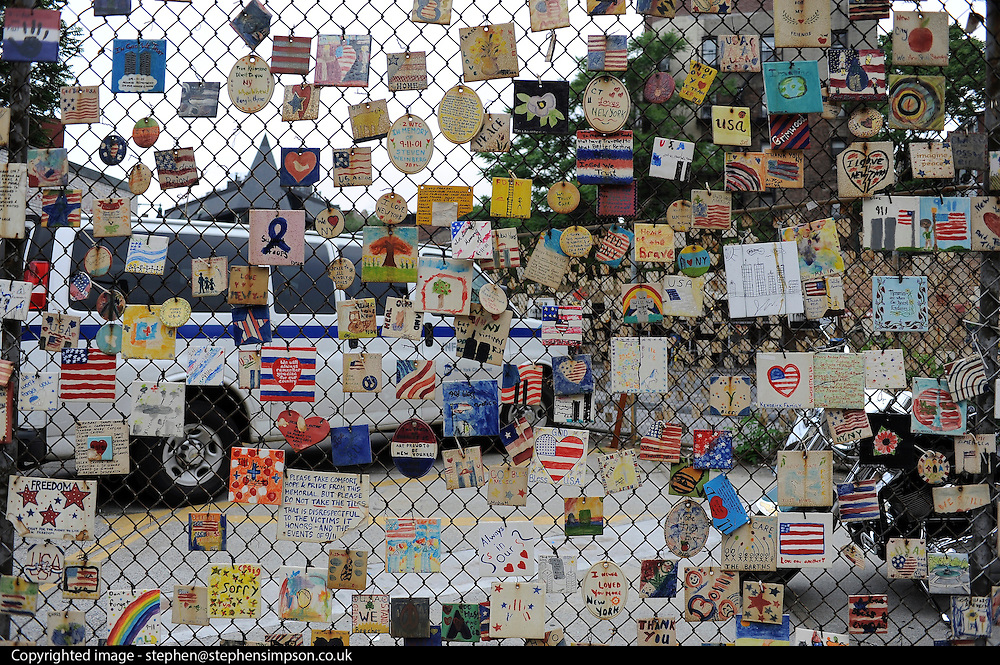 © licensed to London News Pictures. New York, USA  29/05/11.  a 9/11 ceramic tile project hanging on a wire fence in the East Village. Photo credit should read Stephen Simpson/LNP