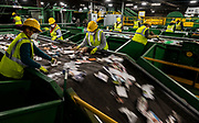Workers take contamination as a form of quality control from the moving conveyer belt of recyclables at Cal-Waste Recovery Systems in Galt on Tuesday, Dec. 22, 2020. The material recovery facility sorts processed recyclable material using optical sorting technology. The machine is designed to do 26-30 tons per hour and the site is projected to process 96,000 tons annually.