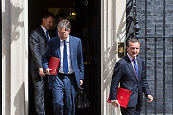 London, July 18th 2017. In a clear demonstration of unity with a cabinet that has seemed to be split over Brexit and other issues,  Government ministers, L-R Health Secretary Jeremy Hunt, Secretary of State for Work and Pensions David Gauke and Welsh Secretary Alun Cairns leave the last cabinet meeting together before the Parliamentary summer recess at Downing Street in London.