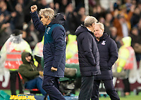 Football - 2018 / 2019 Premier League - West Ham United vs. Crystal Palace<br /> <br /> Manuel Pellegrini, manager of West Ham United,  raises his fist in the air at the final whistle at the London Stadium<br /> <br /> COLORSPORT/DANIEL BEARHAM