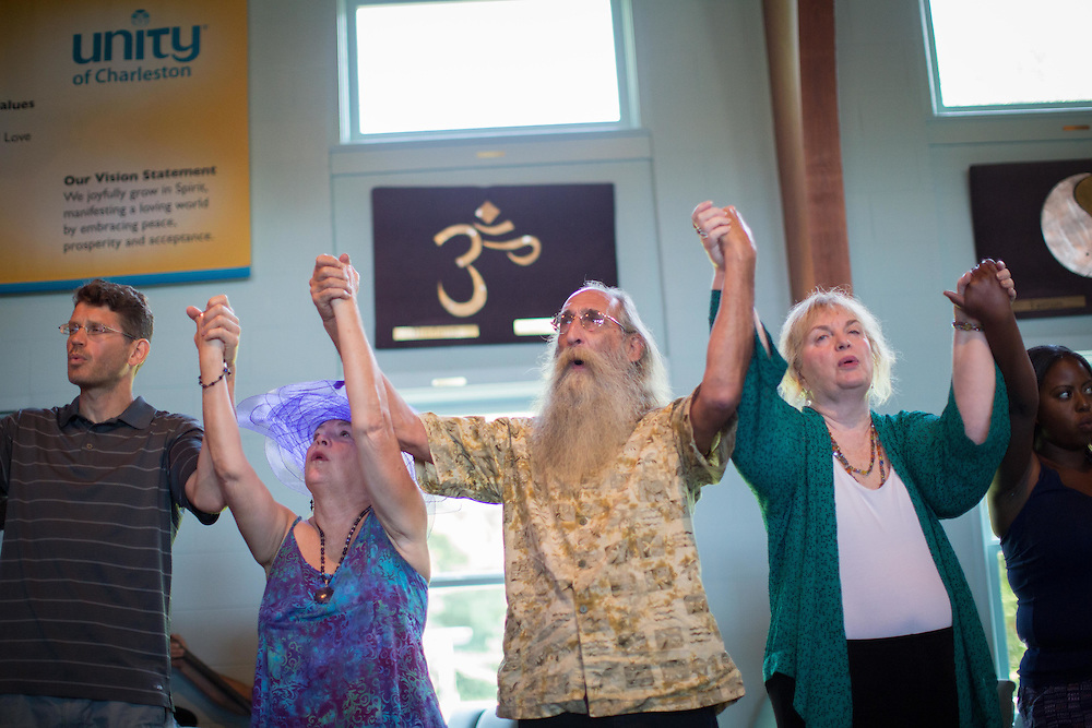 Mourners sing during an interfaith vigil at Unity Church of Charleston on June 20, 2015 in Charleston, South Carolina. The vigil was held for the nine people shot and killed at Emanuel African Methodist Episcopal Church on June 17, 2015. A suspect, Dylann Roof, 21, was arrested in connection with the shootings. Photo by Kevin Liles/UPI