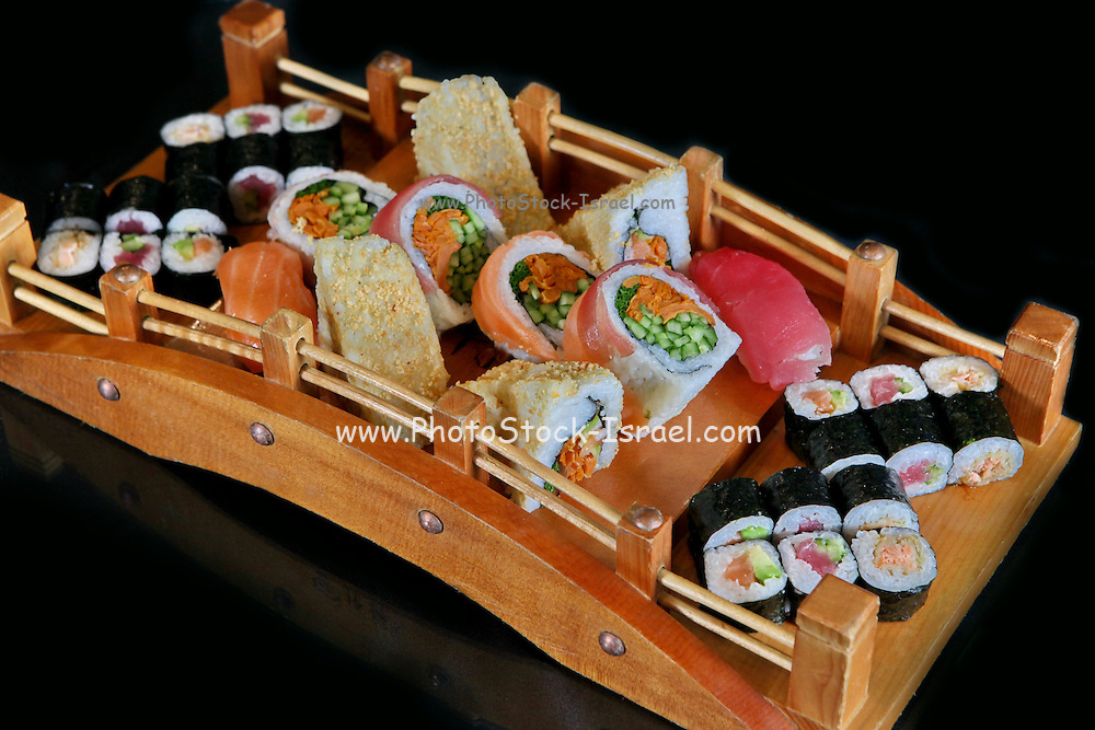 An assortment of various types of sushi including: Sushi Maki, futo maki, Insideout