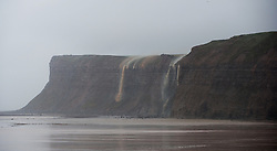 © Licensed to London News Pictures. 25/11/2012..North East England..Rain water creates waterfalls as it runs off Huntcliff in Saltburn, Cleveland following heavy overnight rain which caused traffic disruption and flooding in parts of Cleveland and North Yorkshire this morning...Photo credit : Ian Forsyth/LNP