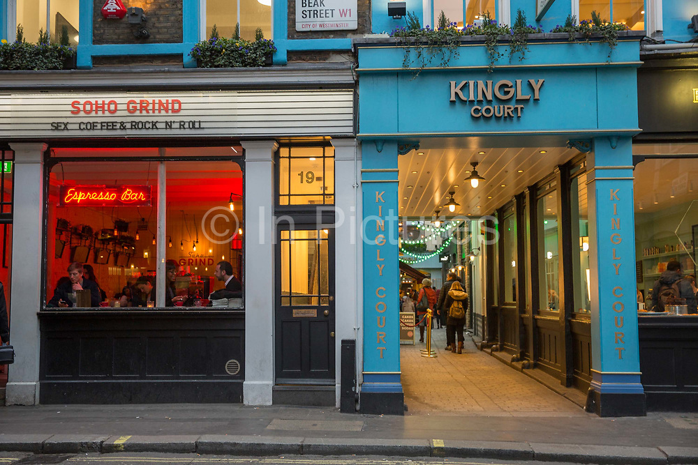 Kingly Court and Soho Grind coffee shop on Beak Street in Soho on the 23rd March 2018 in Central London in the United Kingdom