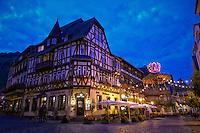 Night view of the Hotel, Restaurant Altkölnischer Hof, sitting on the cobblestone streets of Bacharach, Germany.
