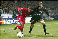 FOOTBALL - CHAMPIONS LEAGUE 2003/04 - 1/8 FINAL - 2ND LEG - 040309 - OLYMPIQUE LYONNAIS v REAL SOCIEDAD - SYDNEY GOVOU (LYON) / LIONEL POTILLON (REAL) - PHOTO GUY JEFFROY /  DIGITALSPORT