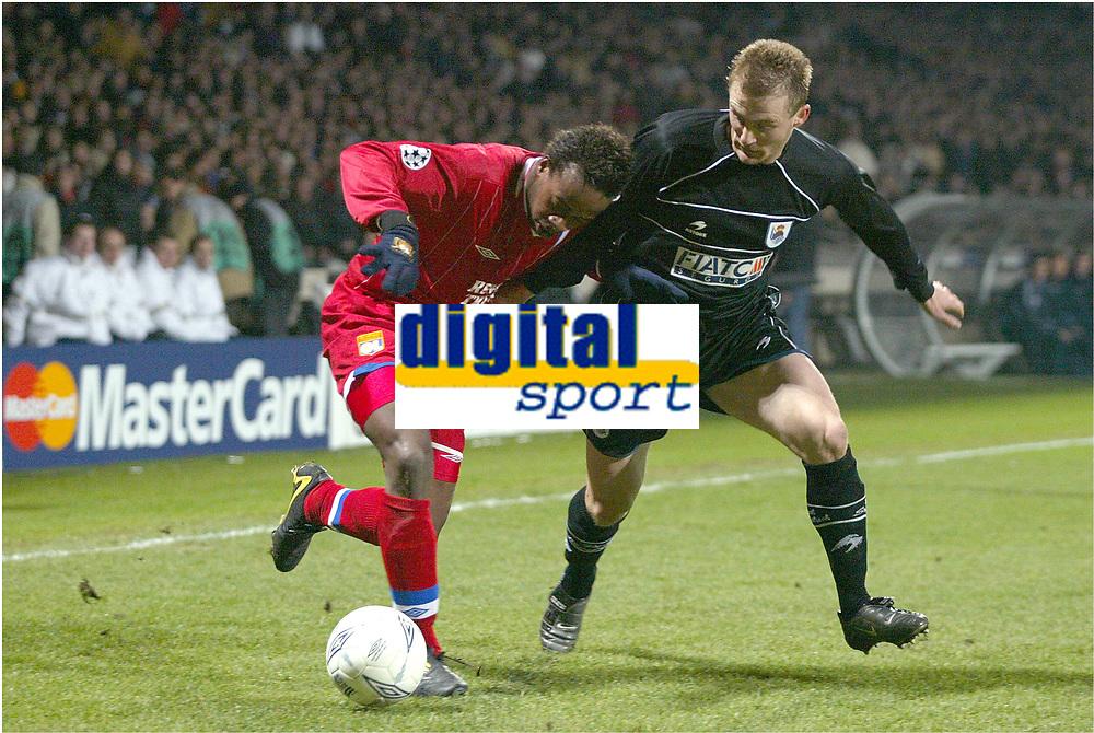 FOOTBALL - CHAMPIONS LEAGUE 2003/04 - 1/8 FINAL - 2ND LEG - 040309 - OLYMPIQUE LYONNAIS v REAL SOCIEDAD - SYDNEY GOVOU (LYON) / LIONEL POTILLON (REAL) - PHOTO GUY JEFFROY /  DIGITALSPORT