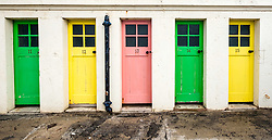 Row of colourful changing rooms at harbour at North Berwick, East Lothian, Scotland, United Kingdom