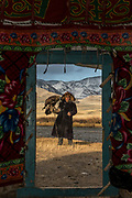Kazakh eagle hunter seen through ger door<br /> Mongolia's largest ethnic minority<br /> Altai Mountains<br /> Western Mongolia