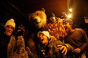 Jamie Sterling, Maya Gaberia, Ramana Van Bastolear and Carlos Burle in front of a stuffed Grizzly Bear in Yakutat, Alaska. MR