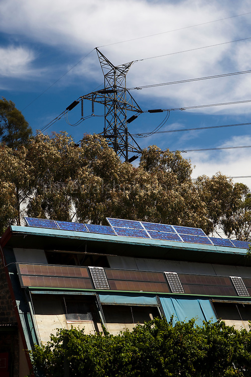Solar panels and electricity pylons at the Centre for Education and Research in Environmental Strategies, Melbourne, Australia