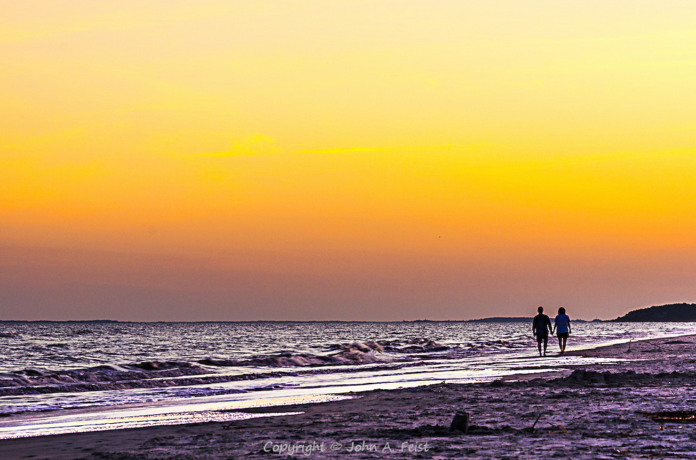 I suspect every photographer has a few of these.  The couple walking hand in hand along the beach at dusk...all is calm, quite and peaceful.  The sky is painted with some beautiful colors to close the day.