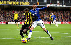 Watford's Abdoulaye Doucoure (left) and Everton's Gylfi Sigurdsson (right) battle for the ball during the Premier League match at Vicarage Road, Watford.