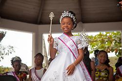 "St. John Festival Princess 2016, Akahiya Heywood, receives her crown.  The Festival & Cultural Organization of St. John Presents It's Annual Food Fair honoring Delroy ""Ital"" Anthony and Royal Coronation 2016.  Franklin A. Powell, Sr. Park.  St. John, US Virgin Islands.  26 June 2016.  © Aisha-Zakiya Boyd"