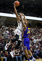 LSU guard Randy Onwuasor (14) blocks the view of Texas A&M guard Savion Flagg (5) as he tries to shoot during the first half of an NCAA college basketball game Saturday, Jan. 6, 2018, in College Station, Texas. (AP Photo/Sam Craft)