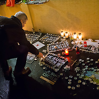 Participant lights a candle to show his support for the terrorist attack victim staff of the Charlie Hebdo satirical weekly in front of the French Embassy in Budapest, Hungary on January 09, 2015. ATTILA VOLGYI