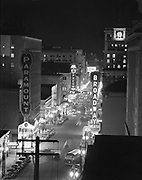 Y-481215-A02.  Portland SW Broadway night shots looking north from the Oregonian Building, Broadway T heatre, Orpheum Theatre December 15, 1948