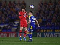Football - 2020 / 2021 Sky Bet League One - AFC Wimbledon vs Wigan Athletic - Plough Lane<br /> <br /> Wigan Athletic's Lee Evans battles for possession with AFC Wimbledon's Callum Reilly.<br /> <br /> COLORSPORT/ASHLEY WESTERN