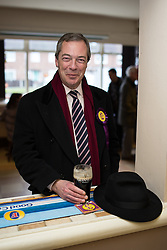© Licensed to London News Pictures . 01/02/2014 . Manchester , UK . NIGEL FARAGE with hit hat and pint of Guinness in The Mountain Ash pub . Nigel Farage , the leader of the UK Independence Party ( UKIP ) joins candidate John Bickley on the campaign trail ahead of the Wythenshawe and Sale East by-election , following the death of MP Paul Goggins . Photo credit : Joel Goodman/LNP