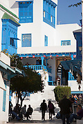 People relaxing in cafes on street, Sidi Bou Said, Tunisia