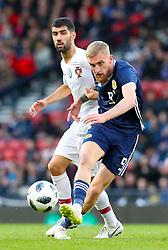 Portugal's Luis Neto (left) and Scotland's Scott McKenna battle for the ball during the International Friendly match at Hampden Park, Glasgow.