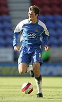 Photo: Andi Thompson.<br />Wigan Athletic v Watford. The Barclays Premiership. 23/09/2006.<br />Wigan's Arjan De Zeeuw