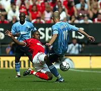 Photo. Chris Ratcliffe<br />Charlton v Man City. FA Premiership. 17/05/2003<br />Shaun Bartlett puts in a challenge on Antoine Sibierski