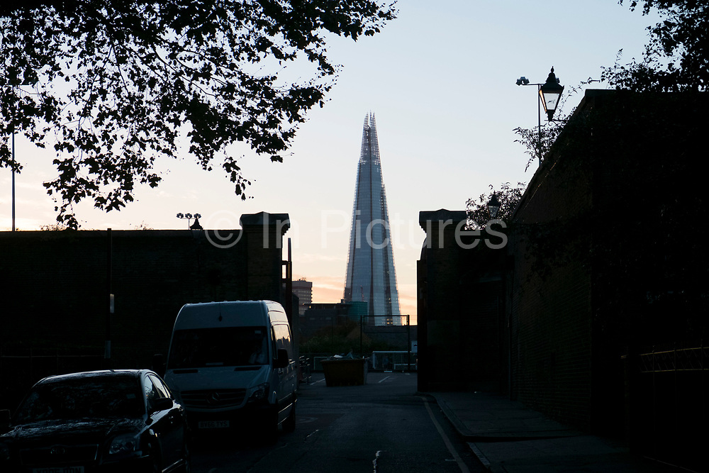 Evening view of The Shard from a quiet street in Wapping in London, England, United Kingdom.