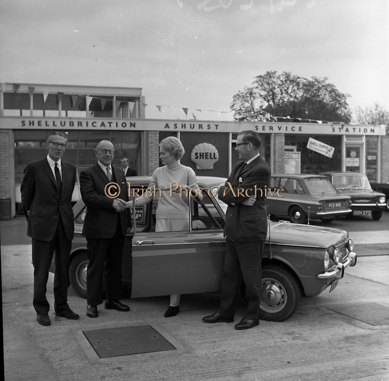 Rosemary Smith in Hillman Imp Endurance Test.  Alec Buckley, Managing Director, Buckleys Motor Club, congratulating Miss Rosemary Smith as she stepped from her Hillman Imp car at the conclusion of a Round Ireland Endurance Run.  On left is Edward Power, Managing Director, Dunlop Ltd and B.A. Nolan, Managing Director of Irish Shell..11.05.1965