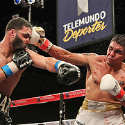 KISSIMMEE, FL - MARCH 05: Rafayel Simonyan gets punched by a right hand from Abraham Tebes during the Boxeo Telemundo All Star Boxing event at Osceola Heritage Park on March 5, 2021 in Kissimmee, Florida. (Photo by Alex Menendez/Getty Images) *** Local Caption *** Rafayel Simonyan; Abraham Tebes