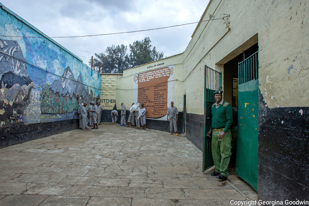 Prisoners returning to Nairobi Remand and Allocation Prison from field work are held and checked for carrying anything in a courtyard near the entrance during celebrations of Talent Behind Bars, a programme held for International Day of the Gifted by the Government of Kenya and representatives from NGOs at the Nairobi Remand and Allocation Prison in the city's Industrial Area, built in 1911 by the British during the colonial period. Participants and inmates came from the Remand and Allocation Prison, Kamiti Main and Medium Prisons and Langata Women's Prison. 10 August 2012